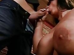 Tattooed hunk gets his cock sucked by chubby busty brunette