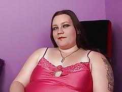 Pale fat momma with tattooes and piercings sticks dildo up her nookie