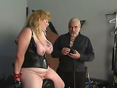 Big tit blonde in leather sucks and rides dildo with helping of her master