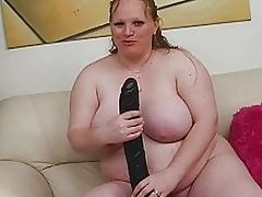 Pale huge redhead momma uses her new sex toy on sofa